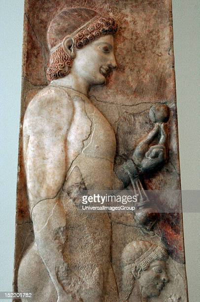 Greek art Archaic era Greece Funerary stele 530 BC Marble Probably comes from Athens Young athlete with a grenade in his hand and an aryballos hung...