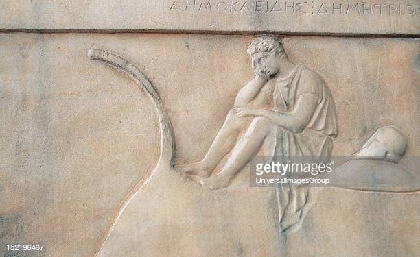Greek art Funerary stele of Democleides Marble relief depicting a warrior sitting sad and meditating on the stern of a ship Beside him his helmet and...