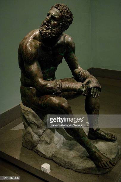 Greek Art Hellenistic Boxer of Quirinal or the Terme Boxer Bronze sculpture of the Hellenistic period Boxer sitting at rest with metal and leather...