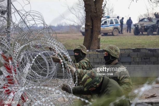 Greek boarder guards prepare border fences at Pazarkule border as they attempt to enter Greece from Turkey on February 29, 2020 in Edirne, Turkey....