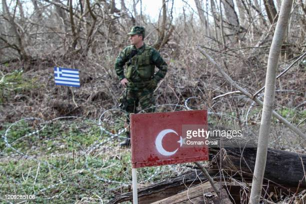 Greek border security guard stand on the border line between Greece and Turkish on February 28, 2020 in Edirne, Turkey. Turkey announced that it...