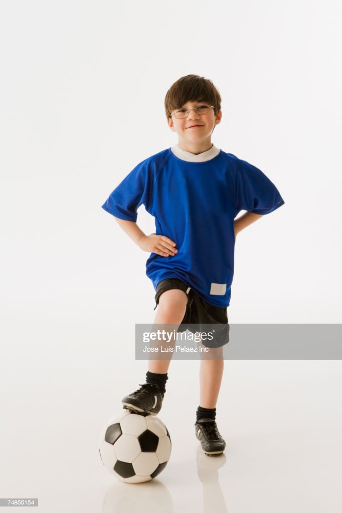 Greek boy with foot on soccer ball : Stock Photo