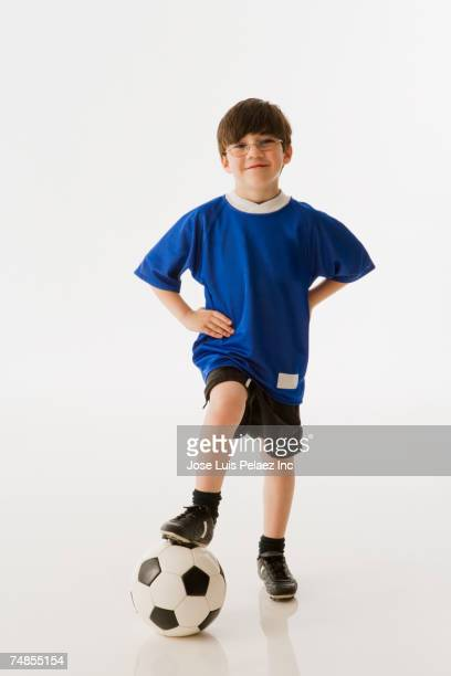 Greek boy with foot on soccer ball