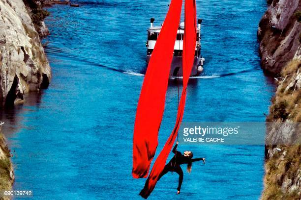 Greek choreographer and dancer Katerina Soldatou performs above the Corinth Canal as part of the Greece Has Soul project on May 30 2017 in Corinth /...