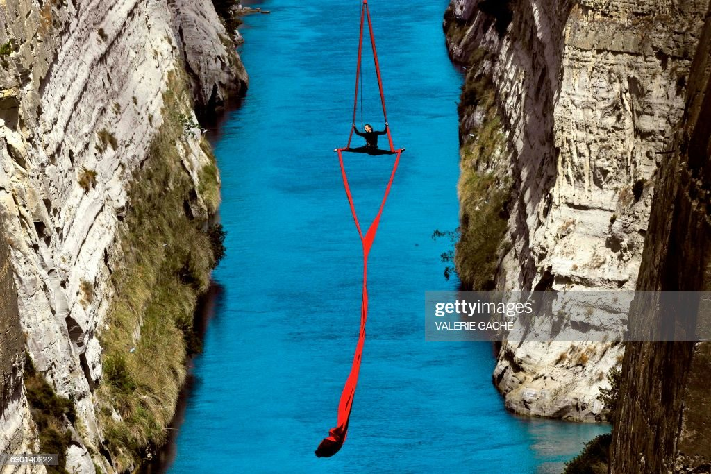 TOPSHOT - Greek choreographer and dancer Katerina Soldatou performs above the Corinth Canal, as part of the Greece Has Soul project on May 30, 2017 in Corinth. /