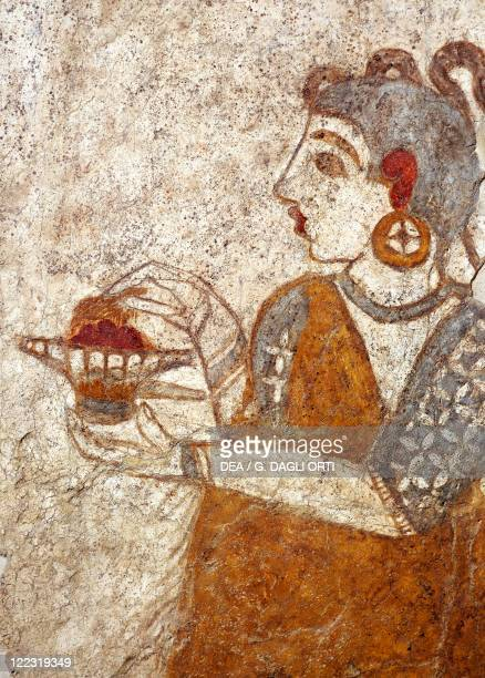Greek civilization 16th century bC Fresco depicting a priestess burning incense From Akrotiri Thera Island Santorini Greece Detail a coastal town