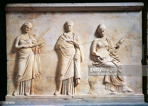 Greek civilization 4th century bC Relief depicting three Muses attributed to the School of Praxiteles From Mantineia Greece