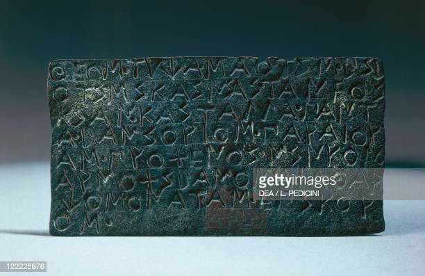 Greek civilization 5th century bC Bronze plate with inscription in Achaean alphabet Text of a will by which Saotis gives his house and properties to...