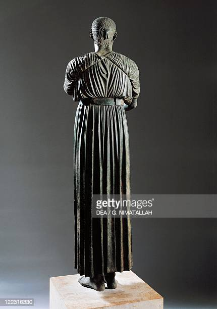 Greek civilization 5th century bC Bronze statue of the Charioteer of Delphi also known as Heniokhos circa 475 bC height 180 cm From Delphi Greece