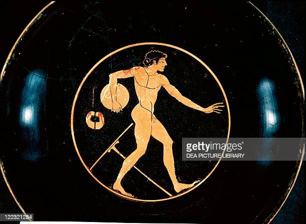 Greek civilization 5th century bC Redfigure pottery Attic kylix depicting a discthrower