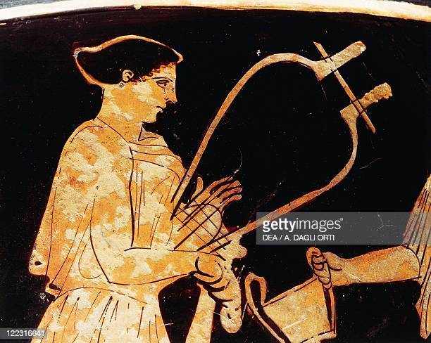 Greek civilization, 5th century b.C. Red-figure pottery. Attic vase. Detail: zither female player.