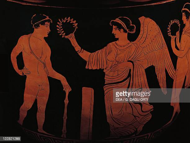 Greek civilization 5th century bC Redfigure pottery Detail depicting Victory crowning an athlete with an olive branch