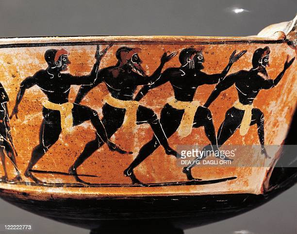 Greek civilization 6th century bC Blackfigure pottery Kantharos depicting athletes running