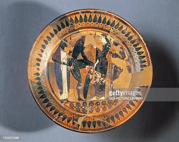 Greek civilization 6th century bC Blackfigure pottery Plate by the painter Lydos depicting Achilles wearing the armor forged by Hephaestus and given...
