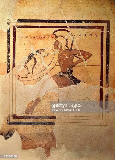 Greek civilization 6th century bC Pinax depicting a Hoplite soldier running