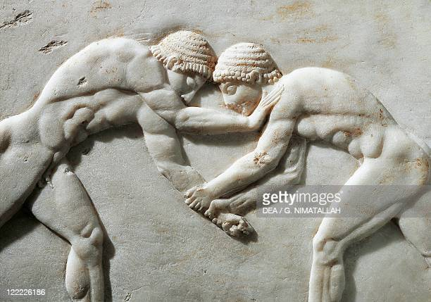 Greek civilization 6th century bC Plinth of kouros statue depicting wrestlers 510 bC Detail Relief from the Kerameikos necropolis in Athens Greece