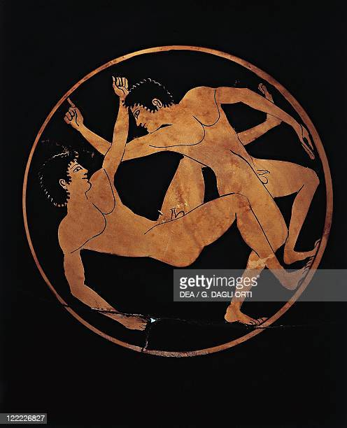 Greek civilization 6th century bC Redfigure pottery Bowl decorated with figures of wrestlers