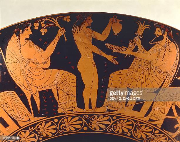 Greek civilization 6th century bC Redfigure pottery Cup depicting scene of assembly of gods Zeus Ganymede and Vesta Detail