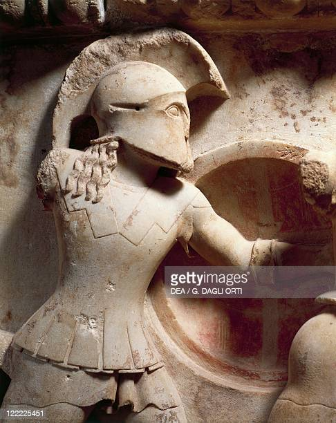 Greek civilization 6th century bC Relief from the gable of the Siphnian Treasury at Delphi Detail depicting Aeneas fighting beneath the walls of Troy
