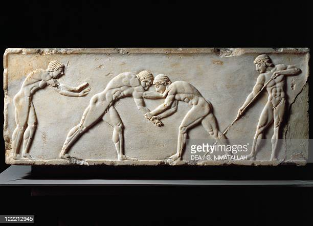 Greek civilization 6th century bC Stele relief depicting a wrestling competition between athletes From Kerameikos necropolis circa 510 bC