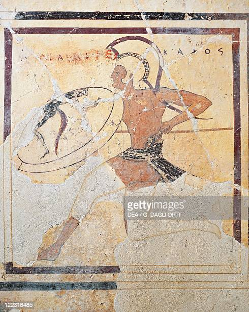 Greek civilization 6th century bC Terracotta plaque with armed Hoplite running
