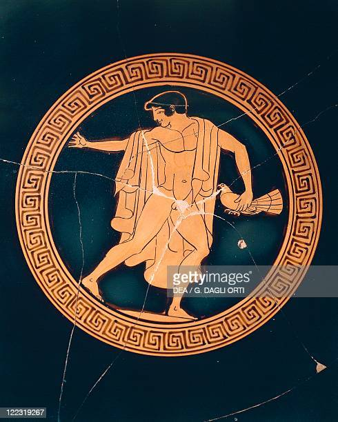 Greek civilization 6th5th century bC Redfigure pottery Detail of a cup depicting an ephebe with a dove