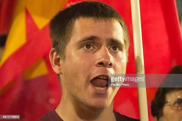 Greek Communist Party supporter shouts slogans while watching the speech of Dimitris Koutsoumbas KKE general secretary