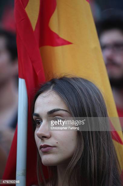 Greek Communist Party supporters listen to speeches during a rally in Syntagma Square near the Parliament on July 2 2015 in Athens Greece As people...