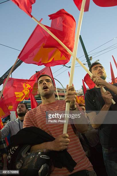 Greek Communist Party supporters shout slogans of support and wave red flags during the party political rally for the municipality elections