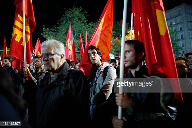 Greek Communists take part in a rally at the Syntagma square in front of the Greek Parliament in Athens on November 4, 2011. Greek lawmakers debated...