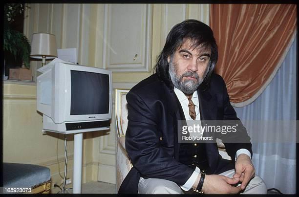 Greek composer and keyboard player Vangelis poses at his apartment in Paris 9th June 1991