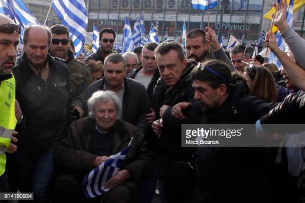 Greek composer Mikis Theodorakis is escorted after his speech during a demonstration February 4 2018 in Athens Greece Protesters gathered in the...