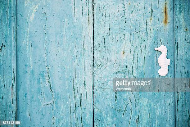 Greek, Cyclades, blue wooden door with a white seahorse