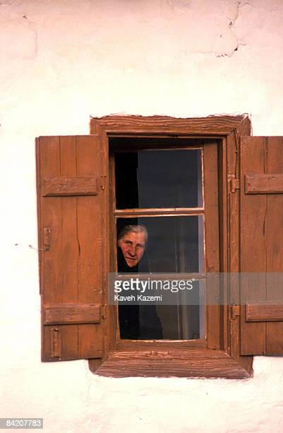 Greek Cypriot woman in traditional black clothing looks out from her window in Lefkara, Cyprus, 8th November 1989.