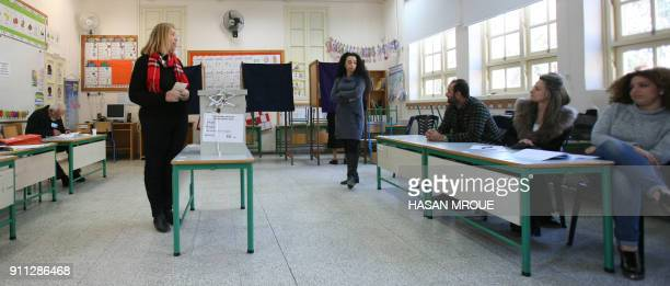 Greek Cypriots are seen at a polling station in the capital Nicosia in the first round of the east Mediterranean island's presidential election on...