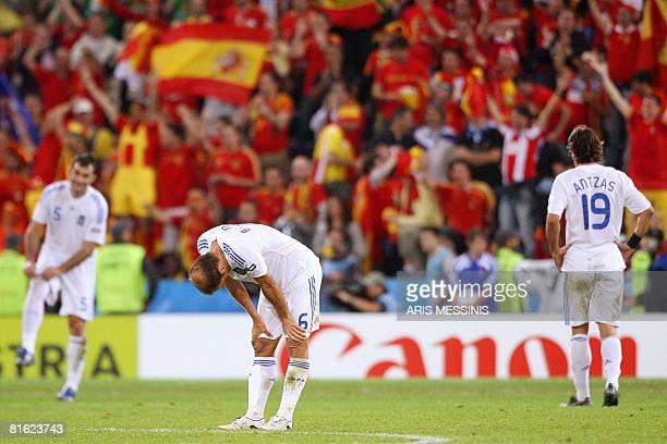 Greek defender Paraskevas Antzas Greek midfielder Angelos Basinas and Greek defender Traianos Dellas look dejected at the end of the Euro 2008...