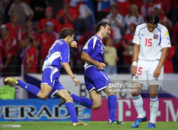 Greek defender Traianos Dellas celebrates his winning goal next to Czech forward Milan Baros , 01 july 2004 at the Do Dragao in Porto, during the...