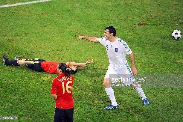 Greek defender Traianos Dellas gestures next to Spanish midfielder Andres Iniesta and Spanish forward Sergio Garcia during the Euro 2008...