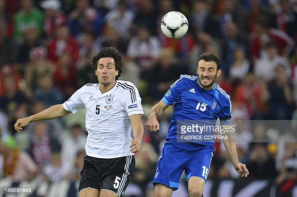 Greek defender Vassilis Torosidis vies with German defender Mats Hummels during the Euro 2012 football championships quarterfinal match Germany vs...