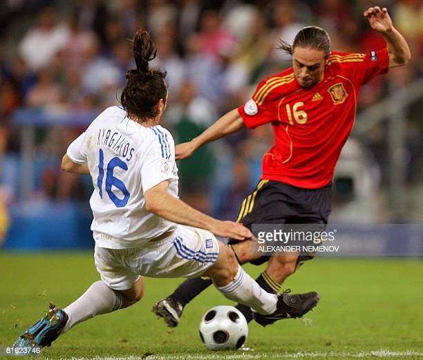 Greek defenderr Sotirios Kyrgiakis vies with Spanish forward Sergio Garcia during the Euro 2008 Championships Group D football match Greece vs Spain...