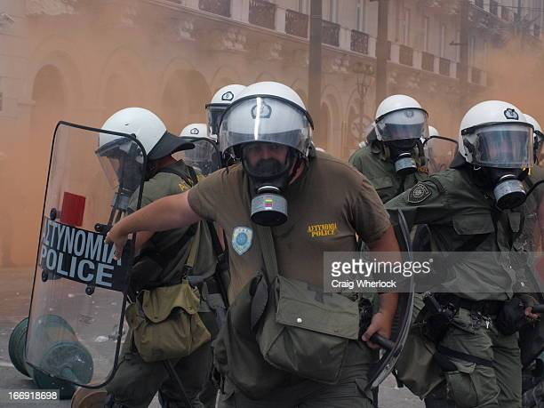 CONTENT] Greek demonstration in Syntagme Square central Athens Riot police units suppress protests