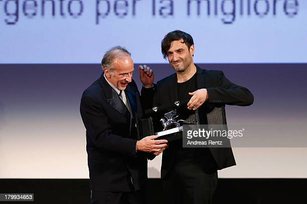 Greek director Alexandros Avranas poses with the Silver Lion for Best Director he received for his movie 'Miss Violence' during the Closing Ceremony...