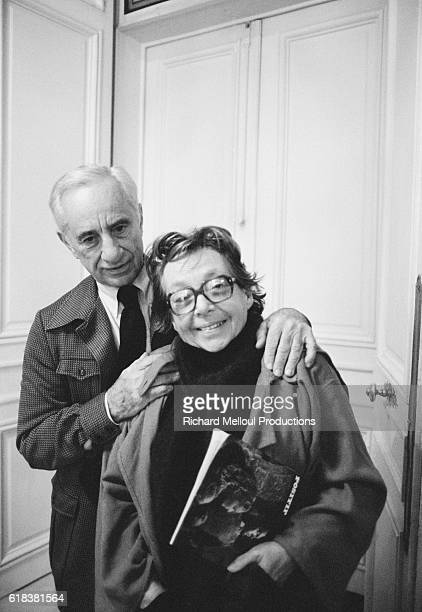 Greek director Elia Kazan stands with French playwright Marguerite Duras at an event in Paris.