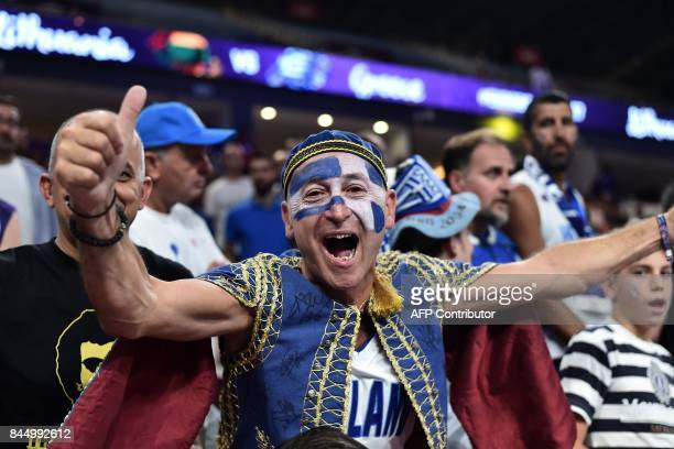 A Greek fan cheers his team during the FIBA Eurobasket 2017 men's round 16 basketball match between Lithuania and Greece at the Sinan Erdem Sport...