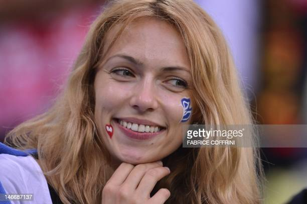 A Greek fan waits for the Euro 2012 football championships quarterfinal match Germany vs Greece on June 22 2012 at the Gdansk Arena AFP PHOTO /...