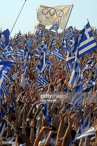 Greek fans celebrate during a welcoming ceremony for Greece's triumphant Euro 2004 soccer team on July 5 2004 in Athens' Panathenaic stadium in...