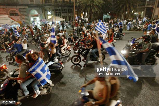 Greek fans celebrate in the centre of Athens 02 July 2004 Greek football national team defeated the Czech Republic 10 and will face Portugal in the...
