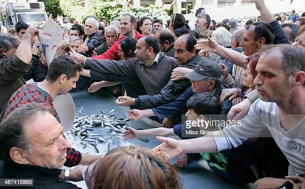 Greek farmers and market vendors distribute free produce as part of a protest after a trade association launched an indefinite strike over the...