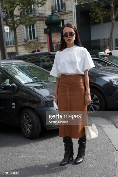 Greek fashion blogger Evangelie Smyrniotaki from Styleheroine wears a Vetements Tshirt Vanessa Seward skirt Jimmy Choo boots Celine bag and...