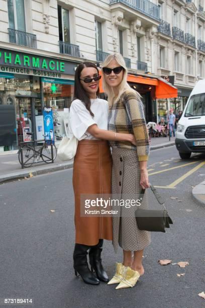 Greek fashion blogger Evangelie Smyrniotaki from Styleheroine wears a Vetements Tshirt Vanessa Seward skirt Jimmy Choo boots Celine bag and...